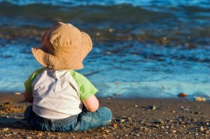 Child sitting on a beach contemplating life :)
